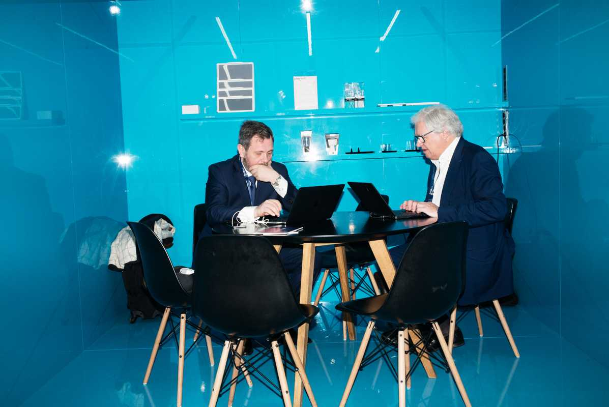 Executives checking their emails in a makeshift office