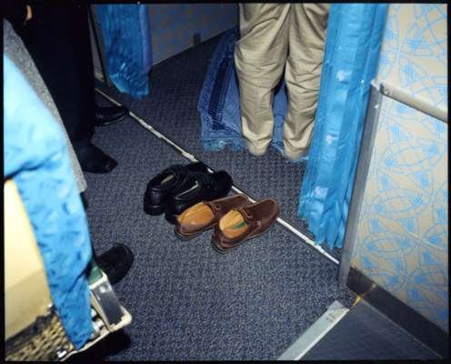 Shoes belonging to passengers outside Flight 744's on-board prayer room