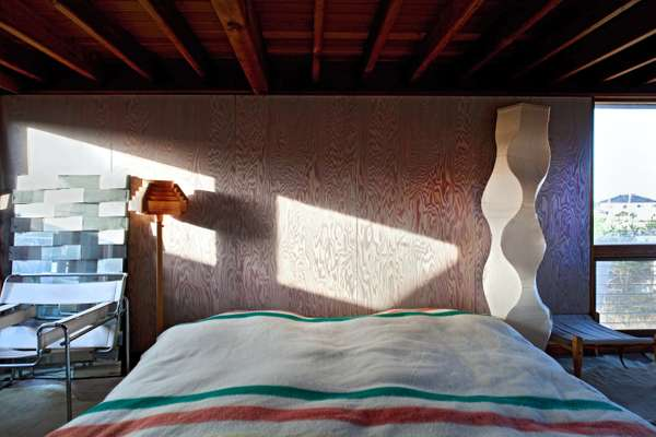 Bedroom: Ito renovated the walls if the bedroom himself. The bed is also handmade.