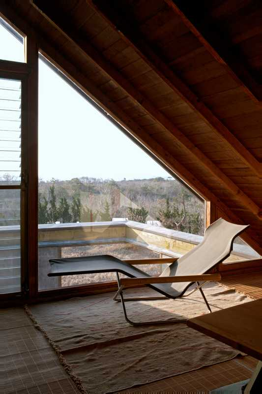 Third-sloor workspace: The workspace has stunning views to the sea. Folding chaise by Takeshi Nii. Ito specialises in design and architecture photography and co-authored *Mod East*, a record of Japanese architecture of the 1950s, 1960s and 1970s.