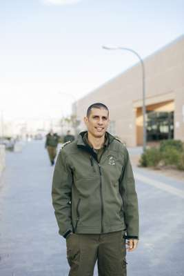 Dror Malal, an IDF driving instructor, in front of the School of Logistics