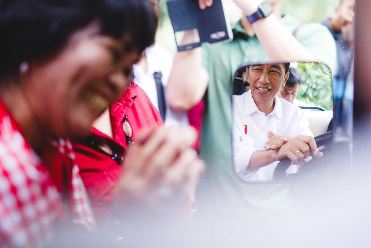 Joko Widodo, known as the people's president, meets the public outside the presidential palace