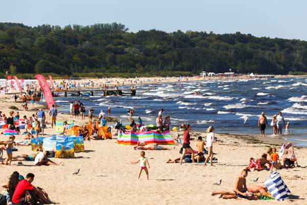 City-dwellers relax on the beach in Sopot