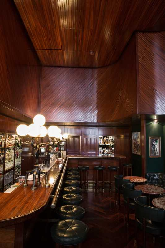 Bar with teak panelling and Giacometti lamp