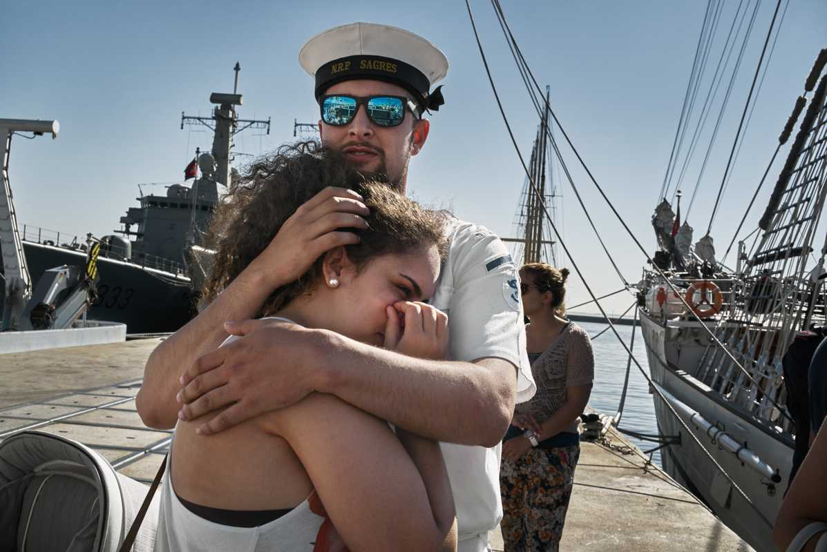 Sailor Diogo Amorim says goodbye to his girlfriend Danielle as the 'Sagres' prepares for its three-month deployment to Brazil
