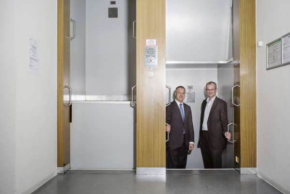 ThyssenKrupp Elevator's CEO Andres Schierenbeck (left) and Markus Jetter, head of research, in the firm's paternoster lift