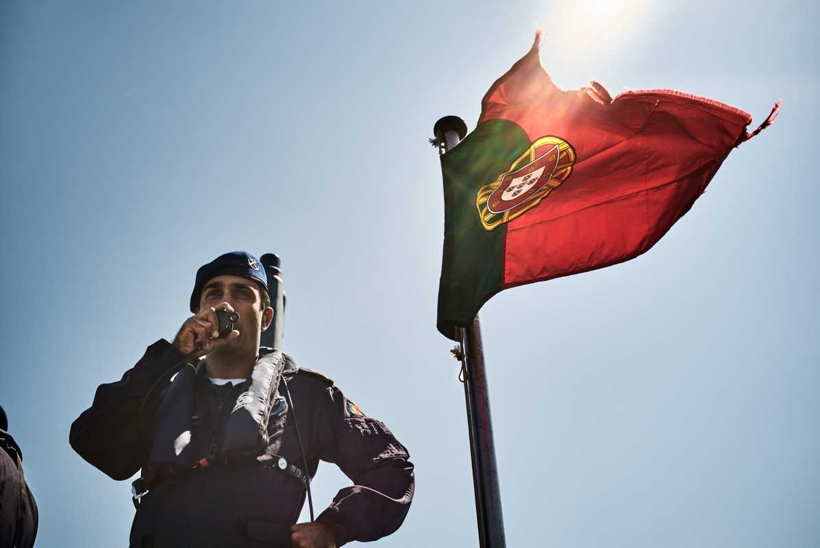 Submarine 'Arpão' Commander Paulo Santos Garcia on the radio to the officer of the watch as the submarine departs from Lisbon harbour
