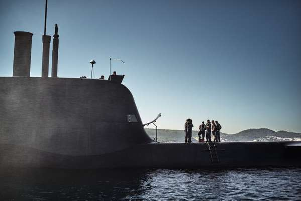 Submariners stand aboard the 'Arpão' as it surfaces off the coast of Portugal