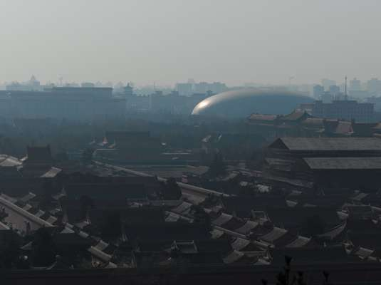 Paul Andreu's National Centre for the Performing Arts seen over the rooftops of the Forbidden City