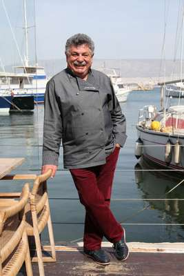Chef Lefteris Lazarou on the terrace outside his restaurant Varoulko
