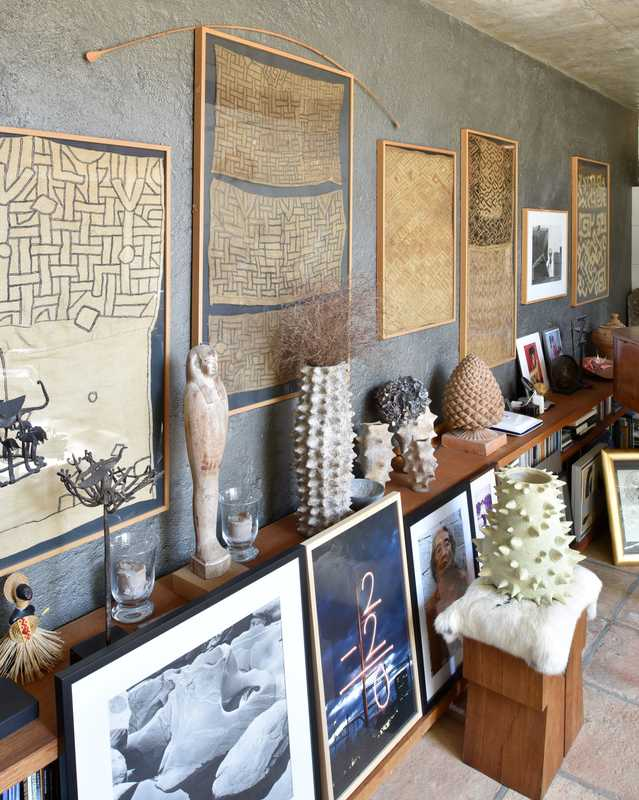 Wall in the living room showing African textiles and artworks from Menchu's gallery days