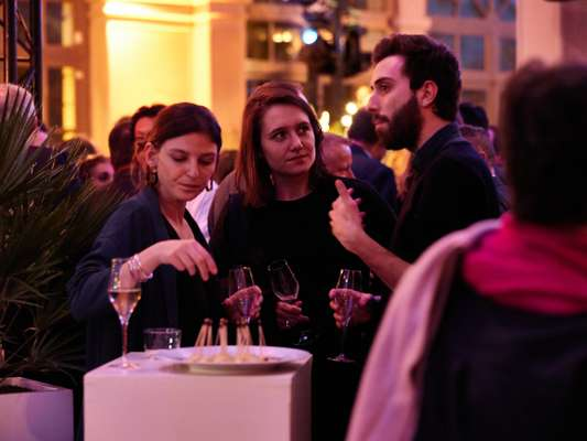 Guests enjoying a digestif after a Live Magazine show in Le Trianon