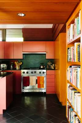 For their kitchen the Mabes repurposed the Cherokee red of Harris's original front door