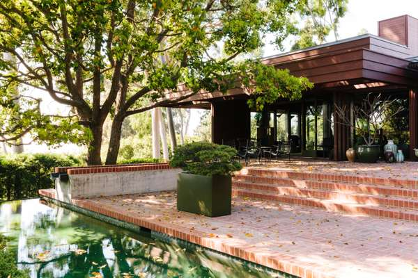 The Mabes enlarged Harris's original brick patio and added a lap pool (