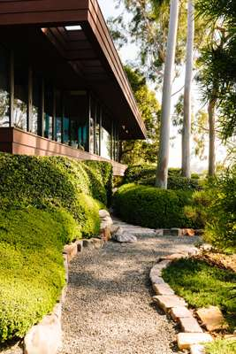 Japanese-inspired gardens surround the house