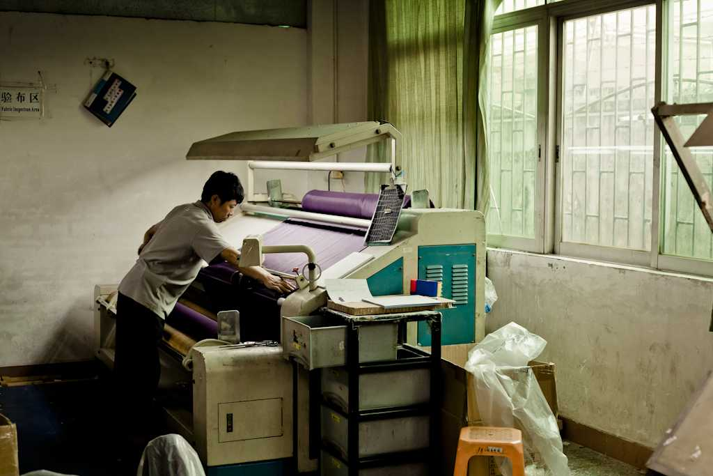 Worker at Lian Hing factory, which makes swimsuits and underwear