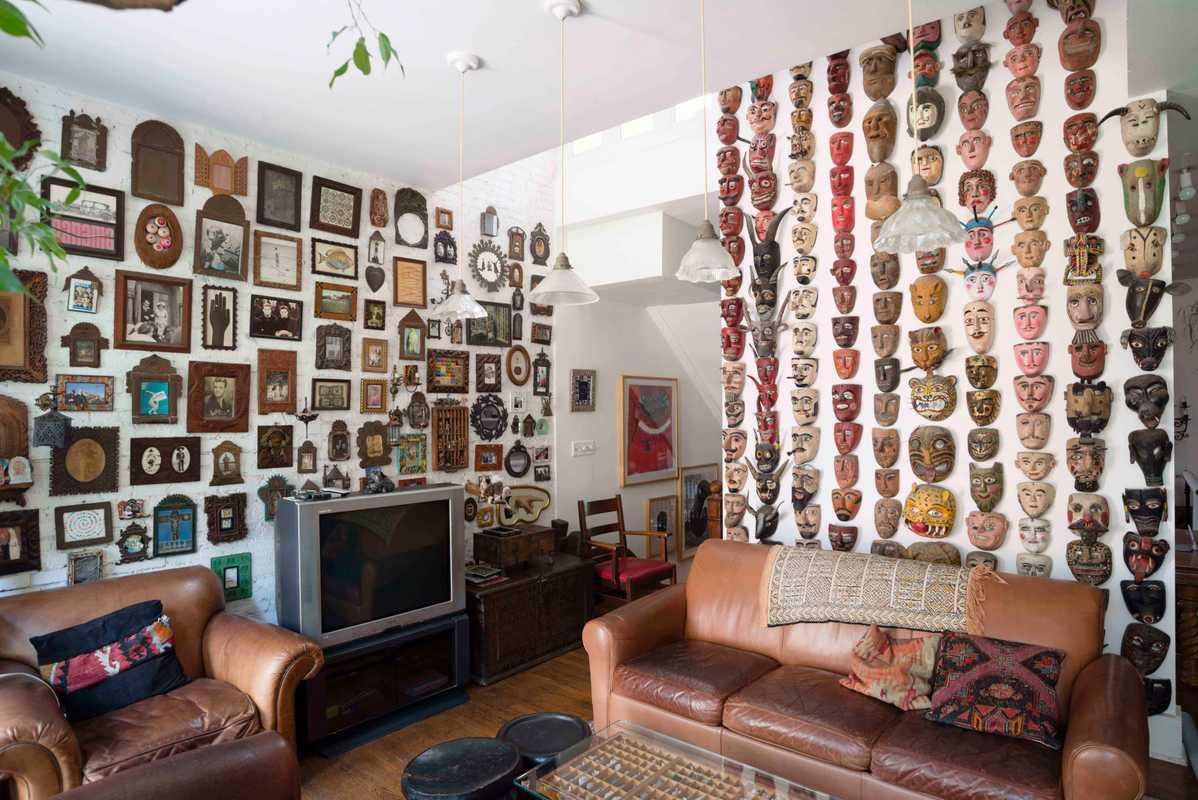Art and travel mementos fill his walls