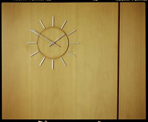 Wall-mounted clock in lobby