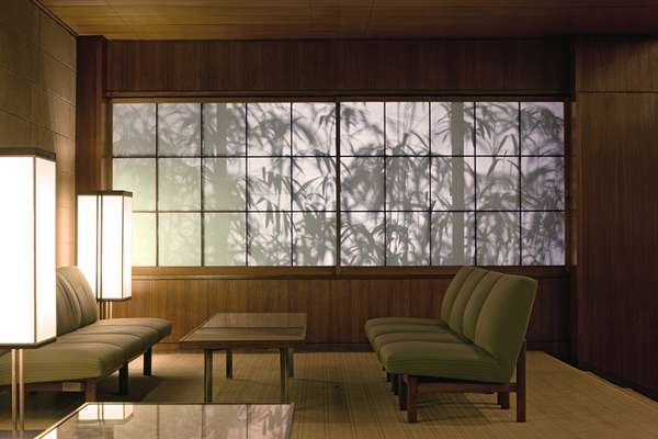 Bamboo silhouetted behind paper screens in the lobby