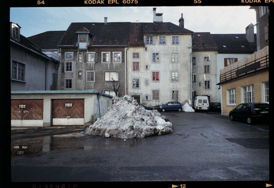 Rue Daniel-Jean Ricard with a pile of thawing snow