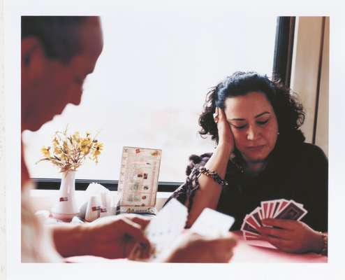 Ladan Jahansouz plays Rummy with the train's chef