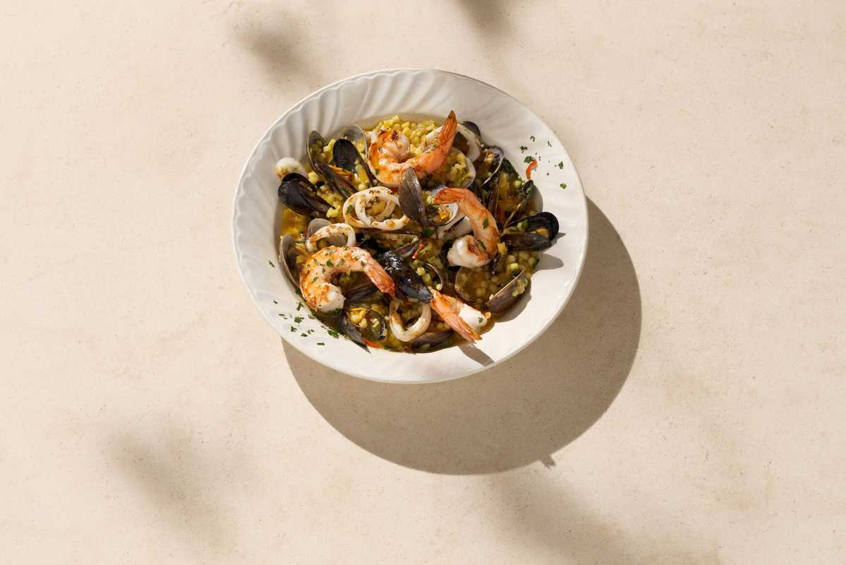 Fregola a pesce: pasta with seafood and saffron