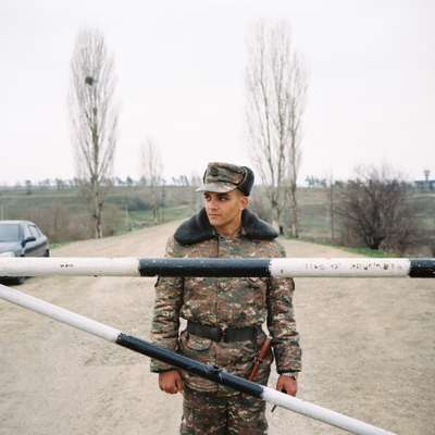 Armenian soldier guarding the entrance of a military base on the outskirts of Stepanakert