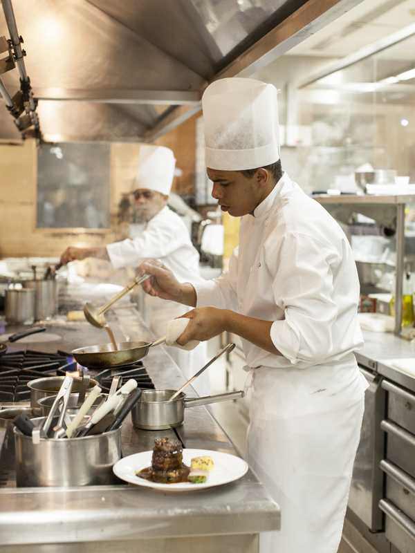 Cook in action at Fasano