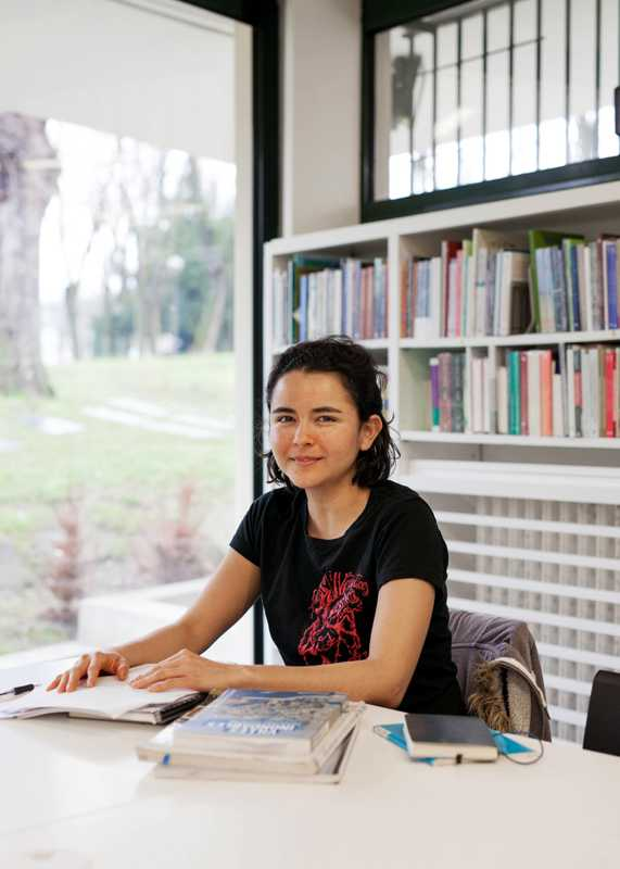 Student in the Maison Mexique library
