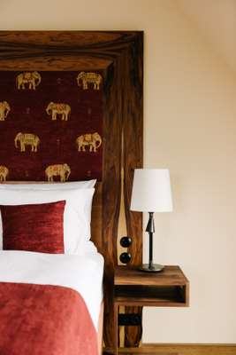 Headboard with signature elephant detail