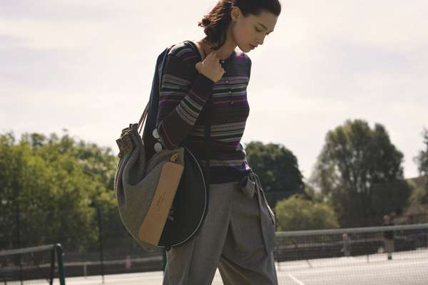 Jumper by John Smedley, trousers by Incotex, bag by Bill Amberg, racquet bag by Yonex