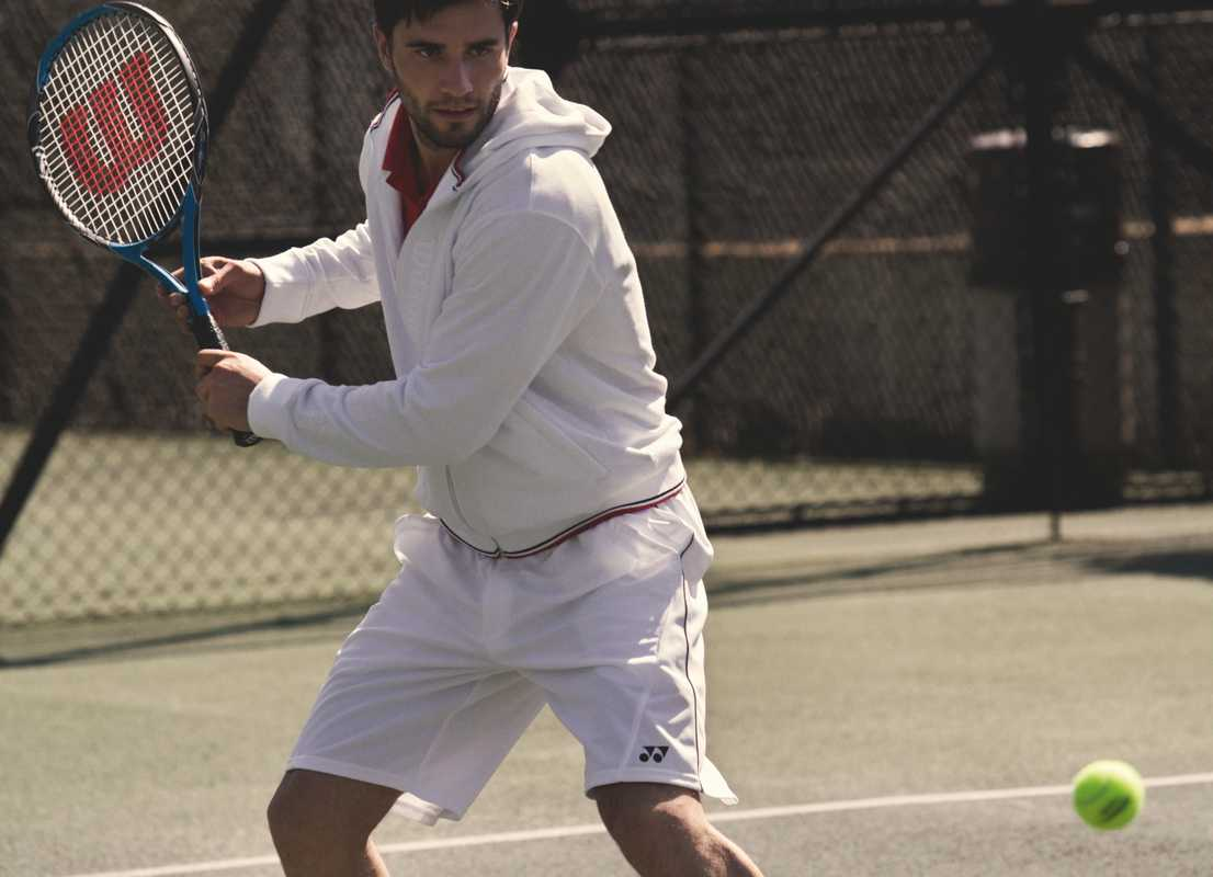 Jacket, racquet and ball by Wilson, polo shirt and shorts both by Yonex