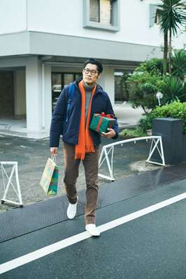 Down jacket by Prada, rollneck jumper by Massimo Alba, trousers by gta, trainers by Golden Goose Deluxe Brand, glasses by Lindberg, scarf by The Inoue Brothers from Wild Life Tailor, backpack by Herschel Supply ––
