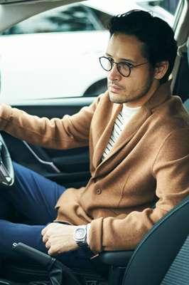 Cardigan by Camoshita United Arrows, jumper by A Kind of Guise, trousers by Ermenegildo Zegna, glasses by Eyevan 7285, watch by Patek Philippe