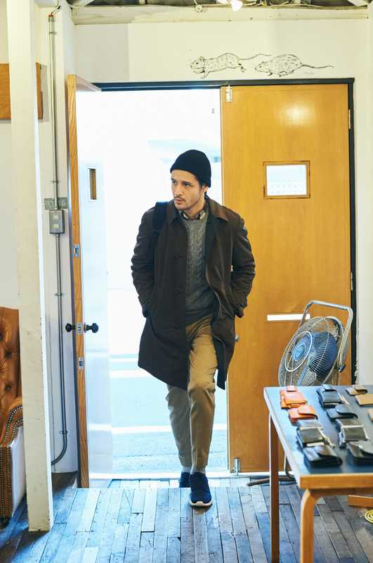 Coat by Boglioli, jumper by Dunhill, shirt by Beams Plus, trousers by Acne Studios, socks by United Arrows, trainers by Nike Sportswear  from Atmos, knit hat  by Kaptain Sunshine, backpack by Digawel