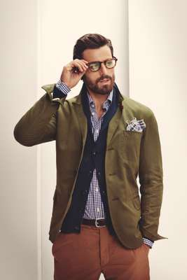 Glasses by Lindberg, jacket by Oliver Spencer, cardigan by Blue Work for Tomorrowland, shirt by Hackett, pocket square by Engineered Garments from Trunk, trousers by Bottega Veneta, belt by J&M Davidson from Trunk