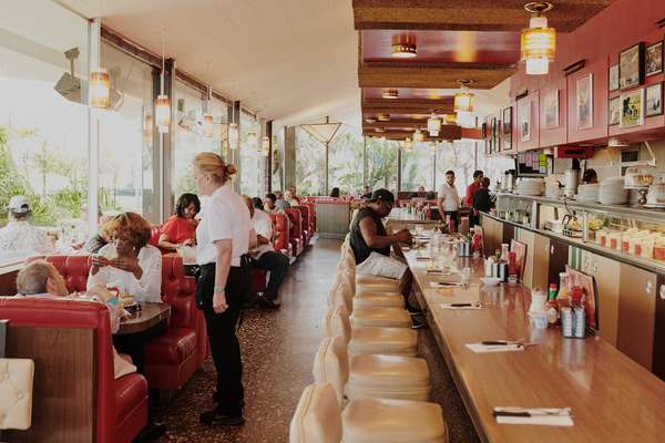 Owner Jim Poulos has been fixing the lighting and banquettes at Pann's to return them to their 1950s best