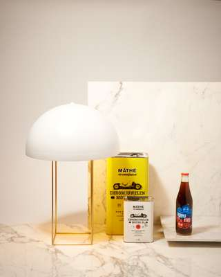 Lamp, motor oil & Karma Cola soda drink