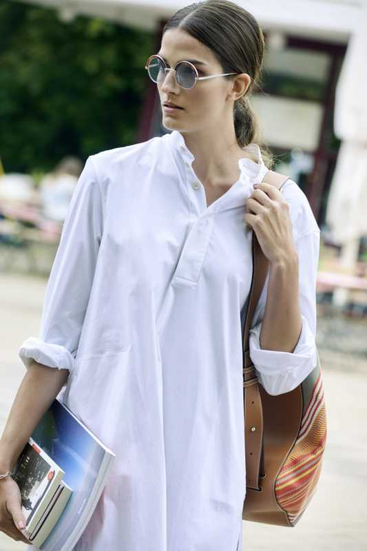 Shirt dress by Connolly, sunglasses by Oliver Peoples pour Alain Mikli, bag by Loewe, bracelet by Saskia Diez