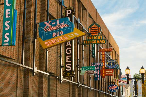 Historic neon signs now sit on a wall downtown