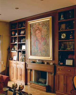 Portrait of the owner takes pride of place inside the home of Paloma Gómez Borrero
