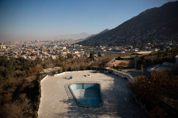 View of Kabul from the fifth floor. The pool and tennis court remain empty