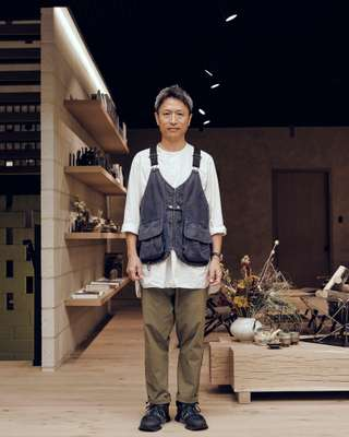 Kei Saito, Snow Peak's UK director, wearing Snow Peak's 'takibi' vest