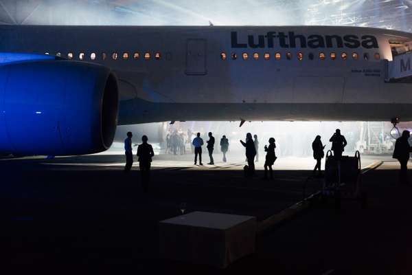 Guests and staff inspect Lufthansa's  new A350 in the hangar
