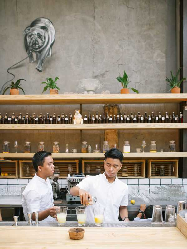 Staff at Three Buns burger restaurant in Jakarta prepare a cocktail