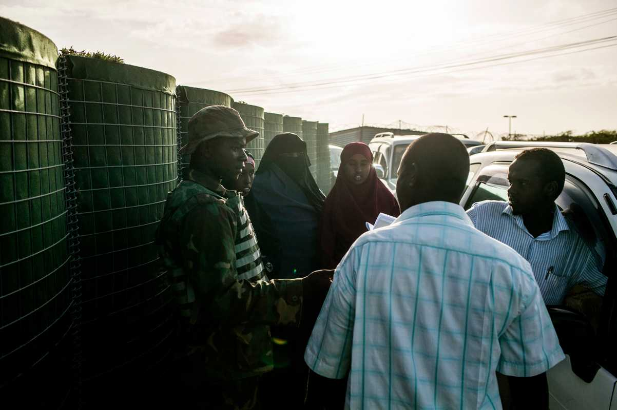 Somalis pass an Amisom security checkpoint