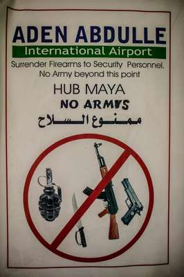 Poster banning weapons inside the airport