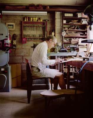 John Yarnall works in the chair shop