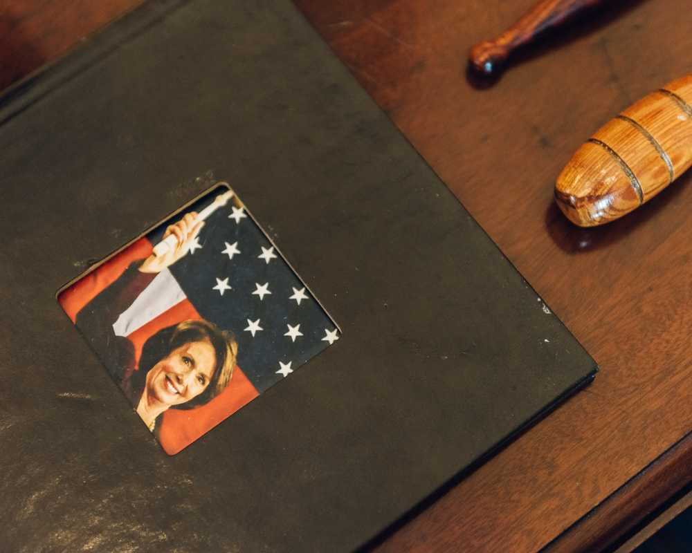 A photo album with an image from Pelosi's acceptance as the first female speaker of the House in 2007