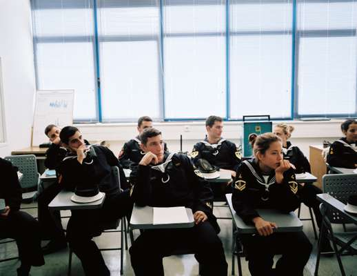 Naval academy students usually sit in class according to their grade